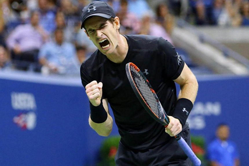 Andy Murray celebrates after winning a point against Grigor Dimitrov in their US Open match.