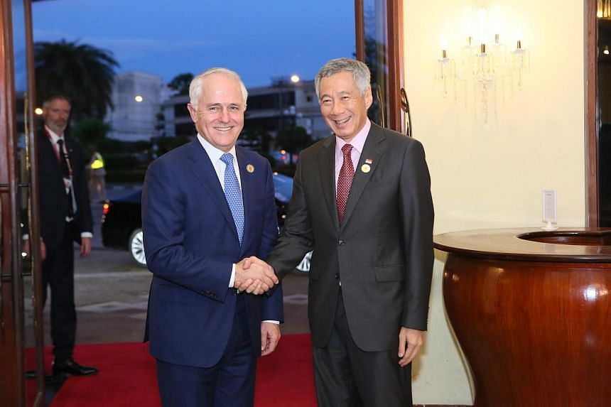 Singapore PM Lee Hsien Loong shaking hands with Australia PM Malcolm Turnbull at the Asean Summit in Vientiane, Laos, on Sept 6, 2016.