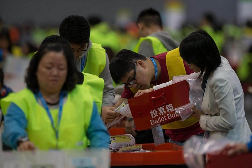 An electoral officer empties a ballot box in the Central Counting Station in Hong Kong, China on Sept 5.