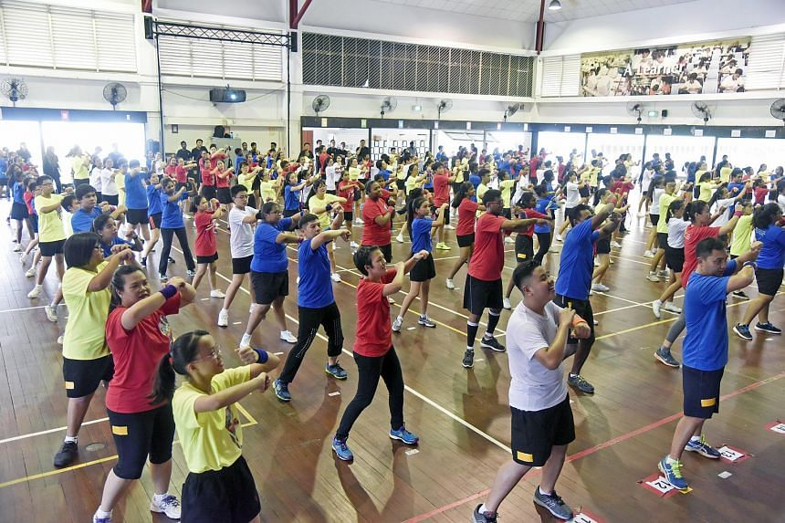Students and teachers at Fuchun Secondary School dancing during a record four-hour zumba marathon on Sept 6, 2016.