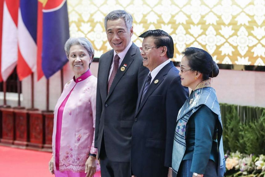 Singapore PM Lee Hsien Loong (centre left) and his wife Mrs Lee posing for a picture with Laos Prime Minister Thongloun Sisoulith (centre right) and his wife Naly Sisoulith at the 28th Asean Summit in Vientiane, Laos, on Sept 6, 2016.