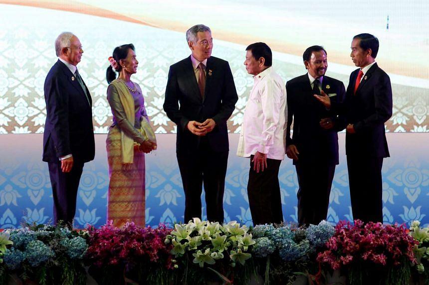 (From left) Malaysia PM Najib Razak, Myanmar leader Aung San Suu Kyi, Singapore PM Lee Hsien Loong, Philippines President Rodrigo Duterte, Sultan of Brunei Hassanal Bolkiah and Indonesian President Joko Widodo attending the 28th ASEAN Summit in Vient