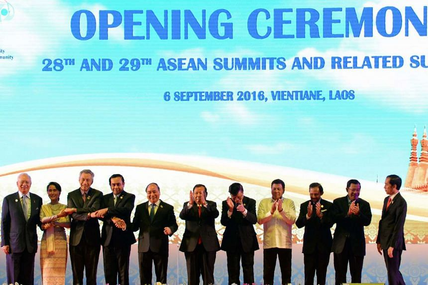 The leaders of the Asean countries pose on stage together during the opening ceremony of the 28th Asean Summit, in Vientiane, Laos, on Sept 6, 2016.