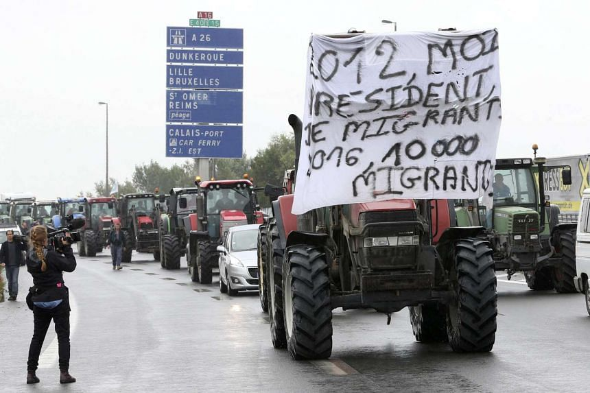 Farmers join harbour workers, truck drivers, storekeepers and residents to attend a protest demonstration on the A16 motorway against the migrant situation in Calais, France.