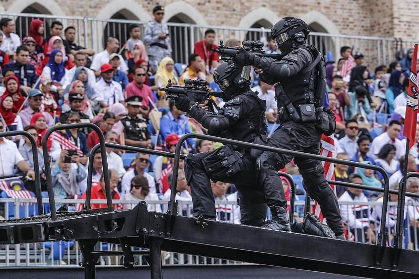 Malaysian Special Force police members demonstrate their skills during the Independence Day celebrations in Kuala Lumpur, Malaysia, Aug 31, 2016.