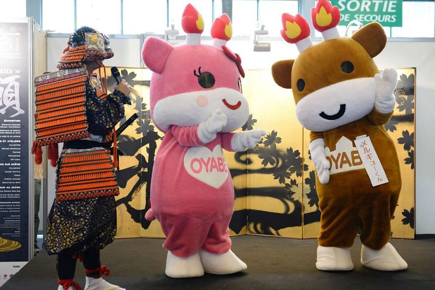 Japanese mascots performing on stage during the 2016 Japan Expo in Villepinte, near Paris, on July 8, 2016.