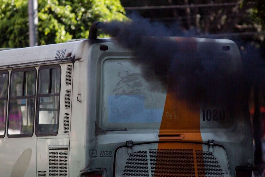 A bus emits exhaust from a pipe in Mexico City, Mexico, on Aug 11, 2016.