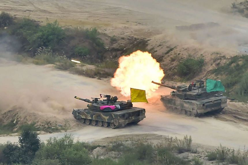 A South Korean K2 tank (right) and K1A2 tank (left) fire rounds during a live fire demonstration on Sept 6, 2016.