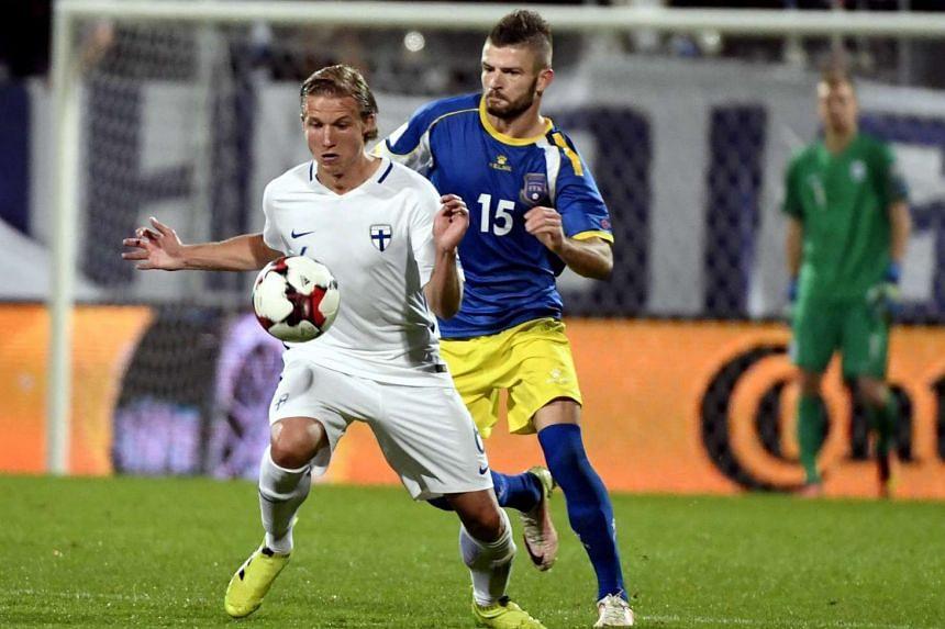 Alexander Ring (left) of Finland and Valon Berisha of Kosovo in action.