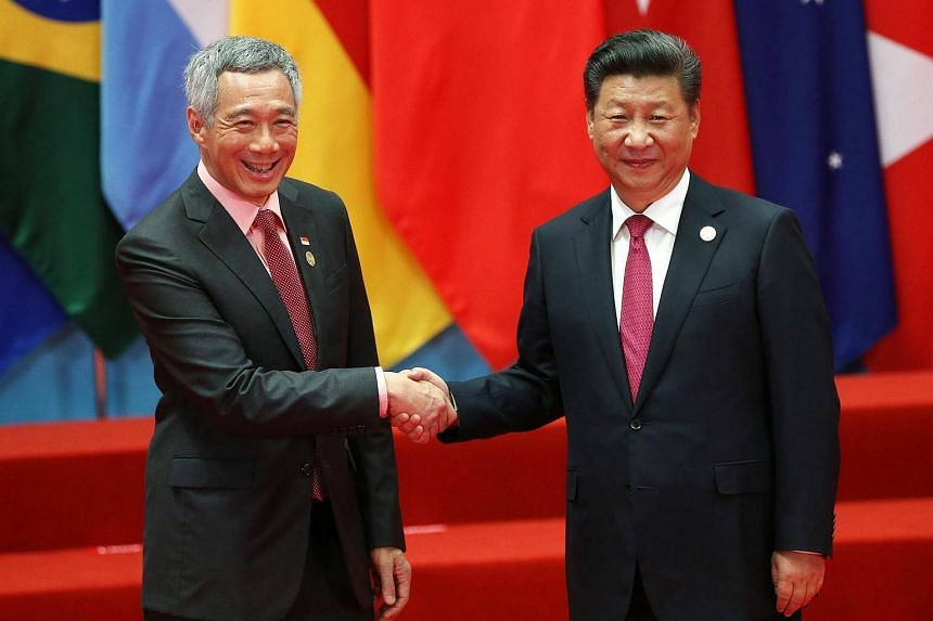 PM Lee Hsien Loong (left) and Chinese President Xi Jinping shake hands during the G20 Summit at the Hangzhou International Expo Center in Hangzhou, China, on Sept 4, 2016.