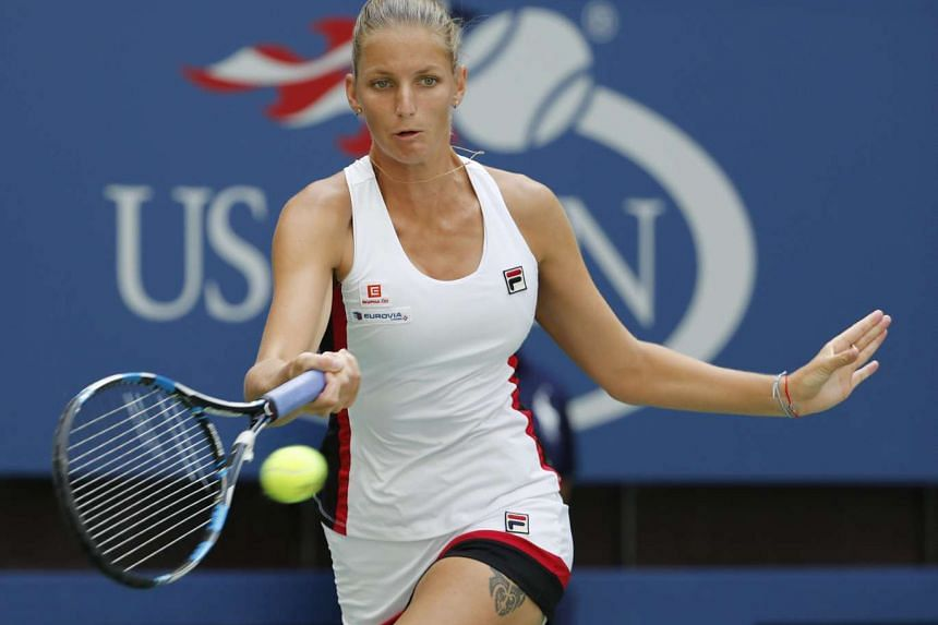 Karolina Pliskova of the Czech Republic hits a return to Venus Williams of the US on the eighth day of the US Open Tennis Championships at the USTA National Tennis Center in Flushing Meadows, New York.