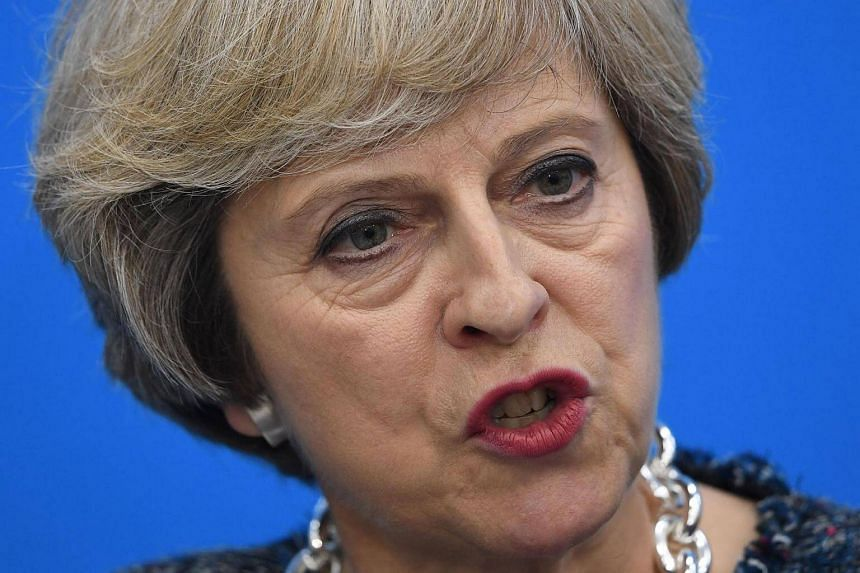 Britain's Prime Minister Theresa May speaks at a press conference after the closing of the G20 Leaders Summit in Hangzhou on Sept 5, 2016.