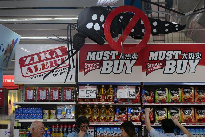 A sign encouraging customers to stay safe and protect themselves against Zika is seen above anti-mosquito products at FairPrice Xtra at Jurong Point on Sept 2, 2016.