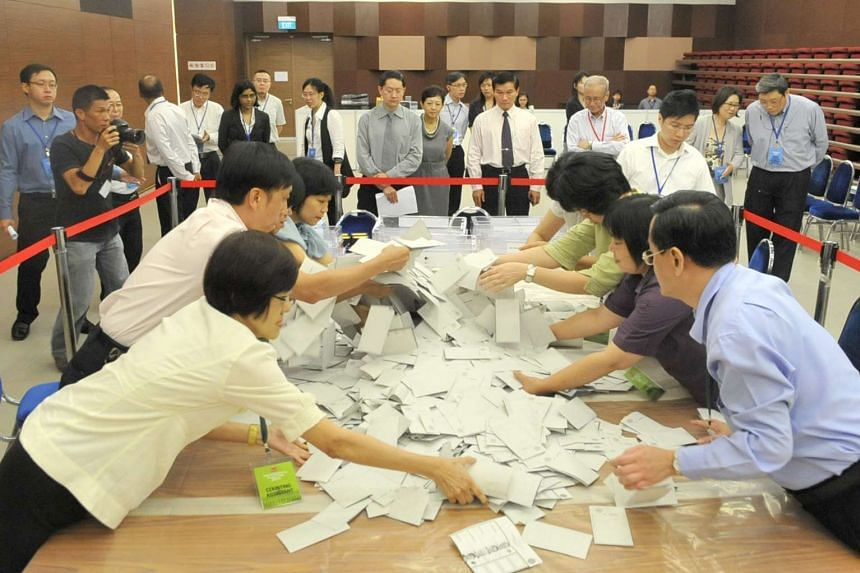 Officials at the People's Association headquarters counting votes cast during the 2011 Presidential Election, on Aug 31, 2011.