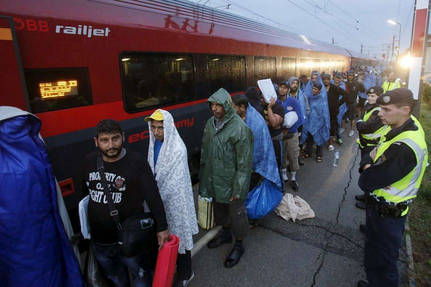 Migrants arriving at the Austrian train station of Nickelsdorf to board trains to Germany on Sept 5, 2016.