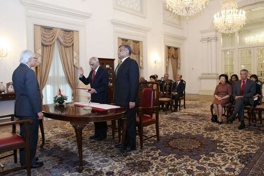 Mr J.Y. Pillay taking his oath during the swearing-in ceremony after being re-appointed the chairman of the Council of Presidential Advisers by President Tony Tan Keng Yam on Jan 2, 2015.