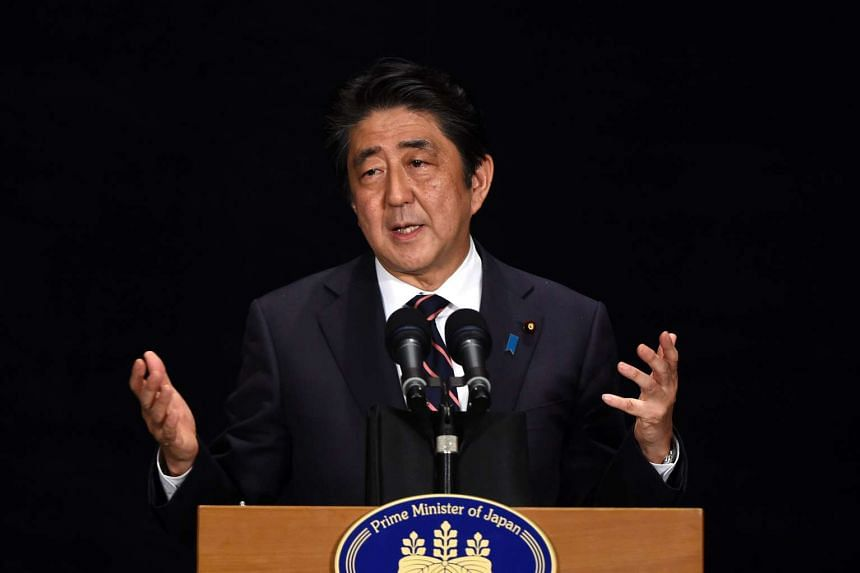 Japan's Prime Minister Shinzo Abe gives a speech at a press conference in Hangzhou during the 11th G20 Leaders Summit on Sept 5, 2016.