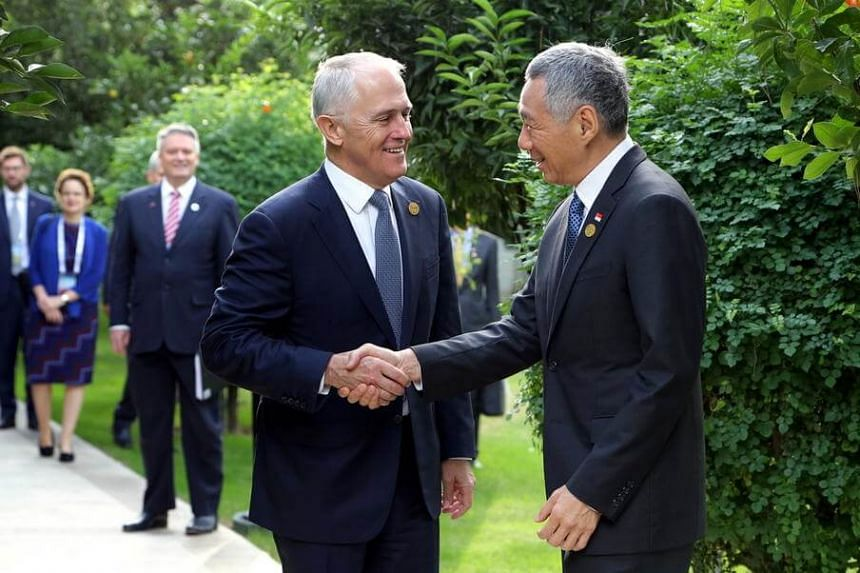 Singapore Prime Minister Lee Hsien Loong (right), shaking hands with Australian Prime Minister Malcolm Turnbull during the G20 Summit held in Antalya, Turkey.