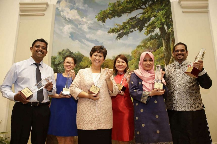 Recipients of the President's Award for Teachers (from left) Mr Anil s/o Vasudevan of Marsiling Secondary School, Ms O Guat Bee of Temasek Primary School, Mrs Lyvenne Chong of Spectra Secondary School, Mdm Michele Tang of Catholic High School (Second