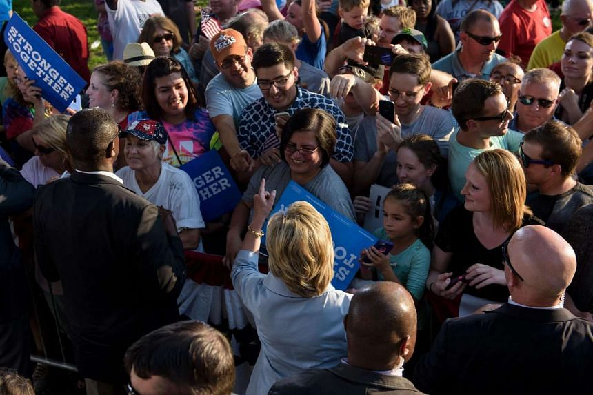 Democratic presidential nominee Hillary Clinton greets supporters after addressing an event at the Illiniwek Campground on Sept 5, 2016 in Hampton, Illinois.