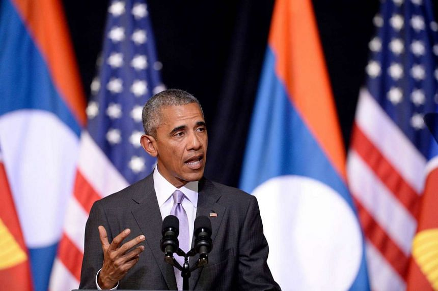US President Barack Obama gestures as he delivers a speech about US-Laos relations at the Lao National Cultural Hall in Vientiane on Sept 6, 2016.