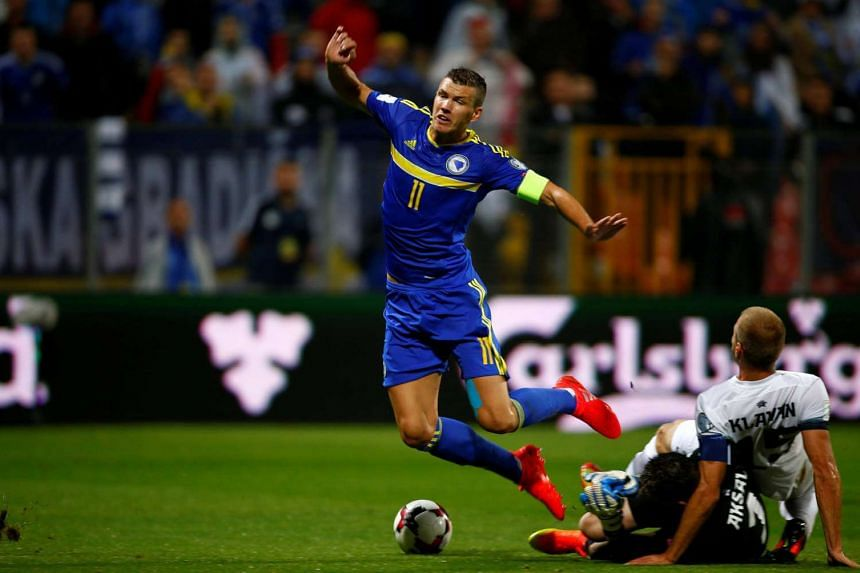 Bosnia's Emir Dzeko fights for the ball with Estonia's Mihkel Aksalu and Ragnar Klavan during the 2018 World Cup Qualifying at Bilino Polje Stadium, Zenica, Bosnia and Herzegovina on Sept 6, 2016.
