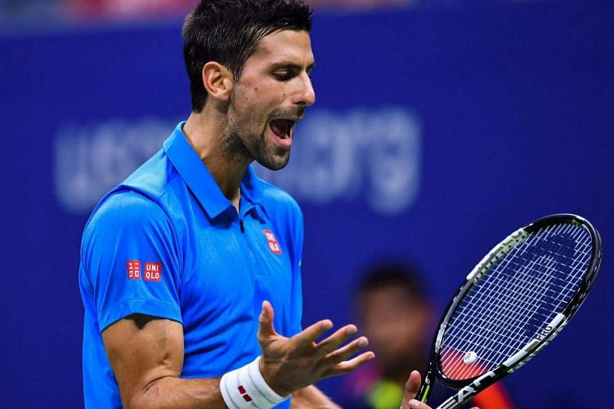 Novak Djokovic reacts after losing a point against Jo-Wilfried Tsonga during their 2016 US Open Men's Singles match at the USTA Billie Jean King National Tennis Center on Sept 6, 2016.