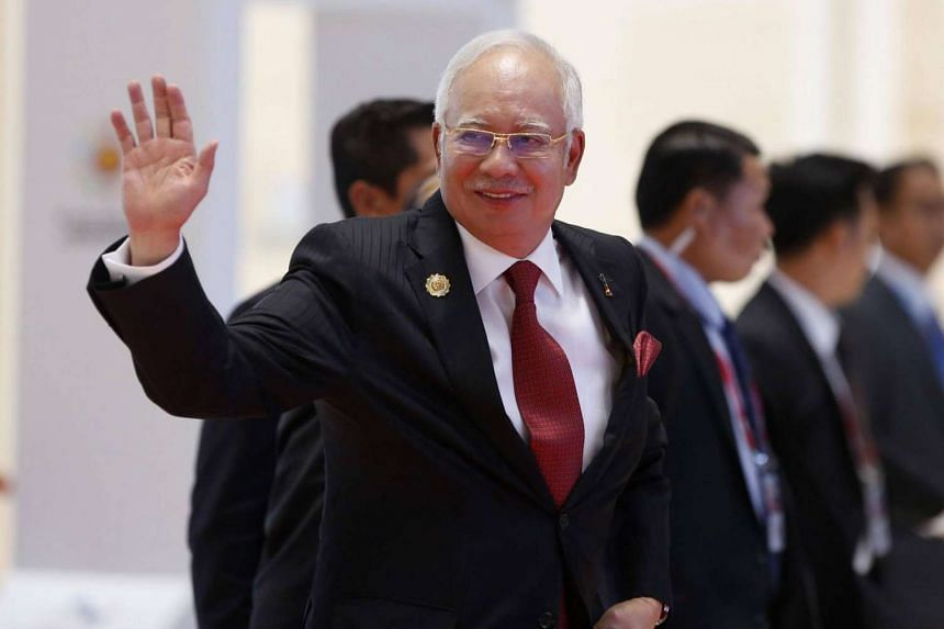 Malaysian Prime Minister Najib Razak arrives at the National Convention Centre in Vientiane for the Asean Summit.