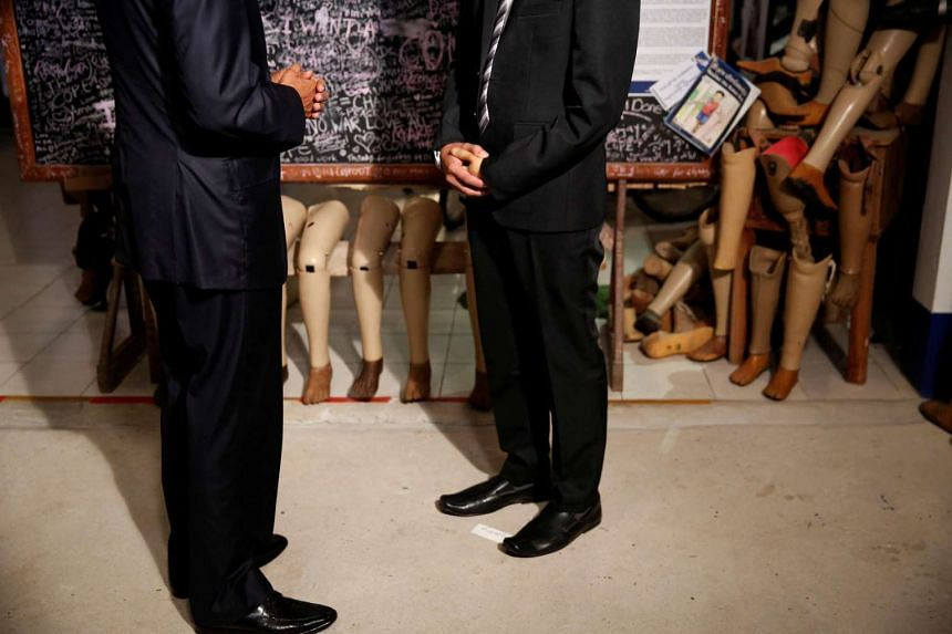 US President Barack Obama (left) meets Thoummy Silamphan, the victim of an accident that cost him his left hand, from the Quality of Life Association, on the sidelines of the Asean Summit, in Vientiane.