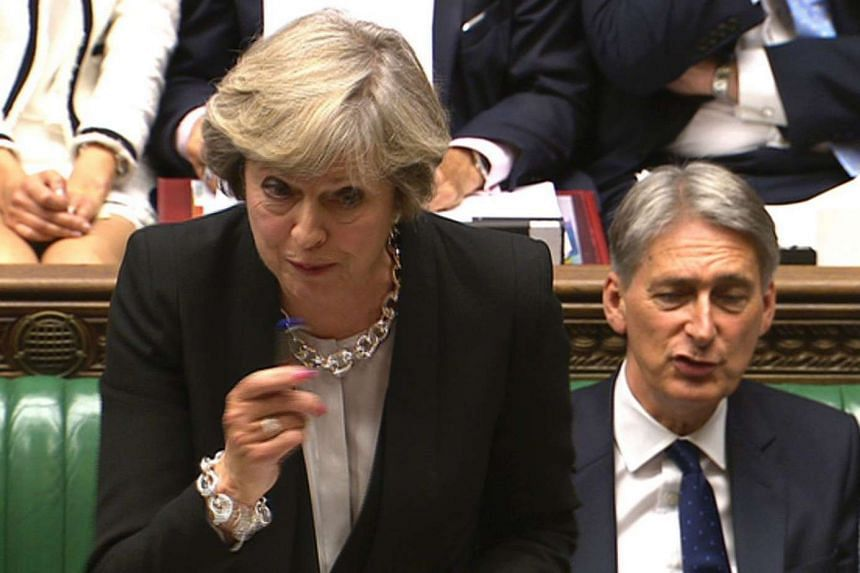 British Prime Minister Theresa May speaks at the dispatch box during Prime Ministers Questions in the House of Commons in central London on Sept 7, 2016.