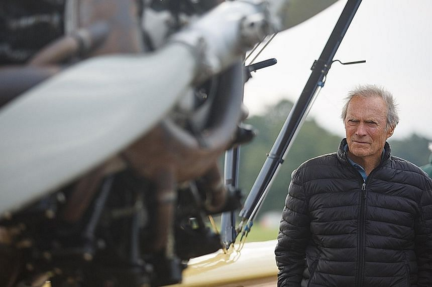 Director Clint Eastwood (above) survived a plane's water-landing in the 1950s himself. His latest movie, Sully, is about a US Airways flight's emergency landing in the Hudson River.