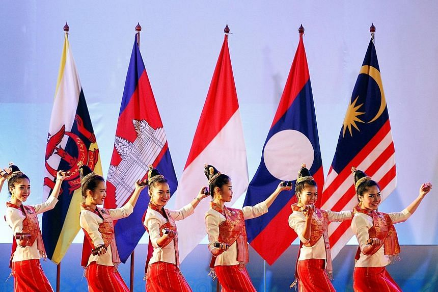 "Dancers performing at the opening ceremony of the Asean Summit in Vientiane, Laos, yesterday. The theme for this year's summit is ""Turning vision into reality for a dynamic Asean community"", where leaders are expected to talk about pressing issues fa"