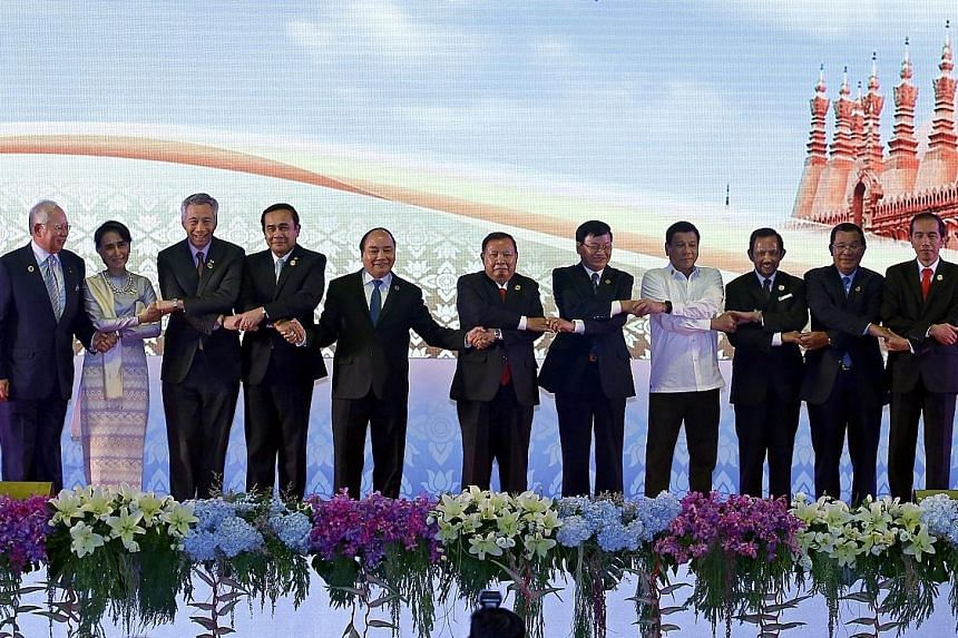 Getting together at the opening ceremony are (from far left) Malaysian Prime Minister Najib Razak, Myanmar State Counsellor Aung San Suu Kyi, PM Lee, Thai Prime Minister Prayut Chan-o-cha, Vietnamese President Tran Dai Quang, Laos President Bounnhang
