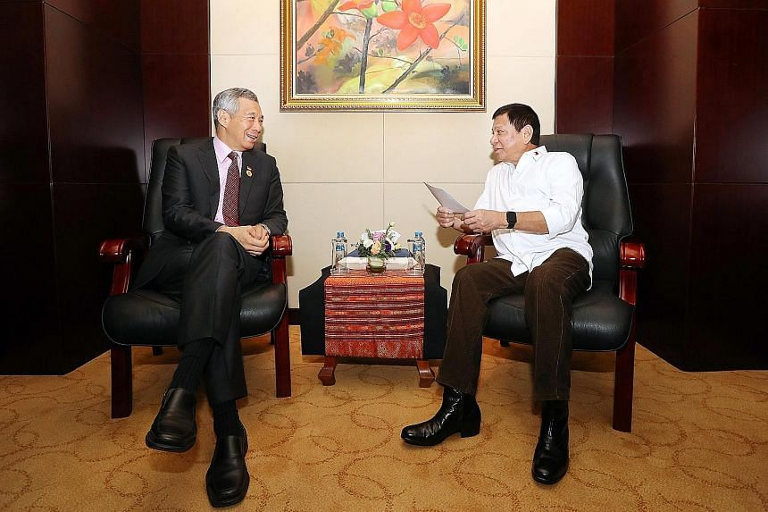 PM Lee meeting Philippine President Duterte in Laos yesterday. They reaffirmed the long and close ties between both countries and looked forward to the celebrations of the golden jubilee of diplomatic relations in 2019.