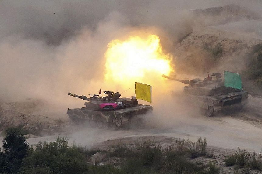 South Korean K1A2 battle tanks in a military live-firing exercise outside Pocheon city near the border with North Korea.
