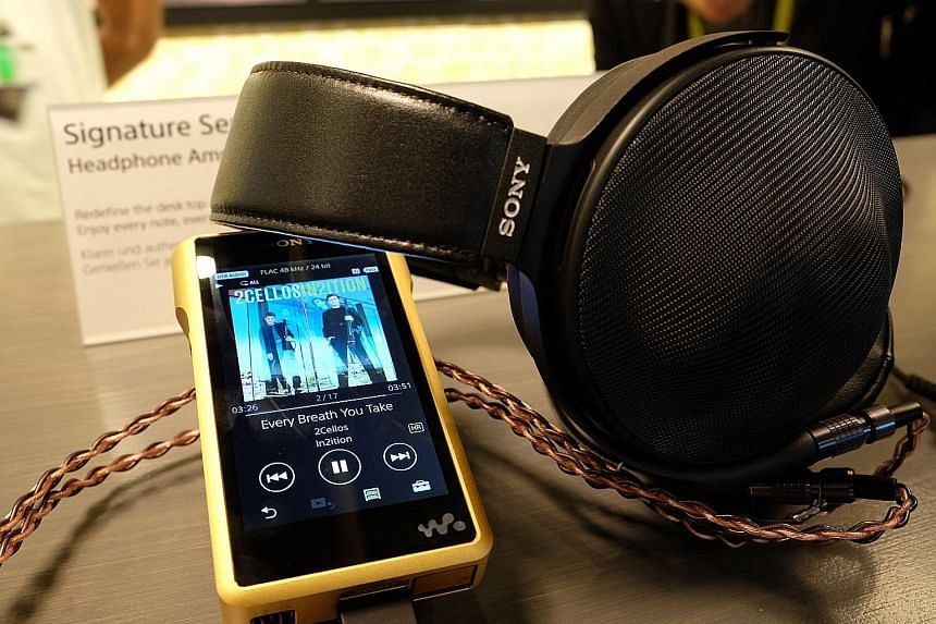 Sony's NW-WM1Z Walkman (left) and MDR-Z1R headphones, part of its new line of products dedicated to high-resolution audio.