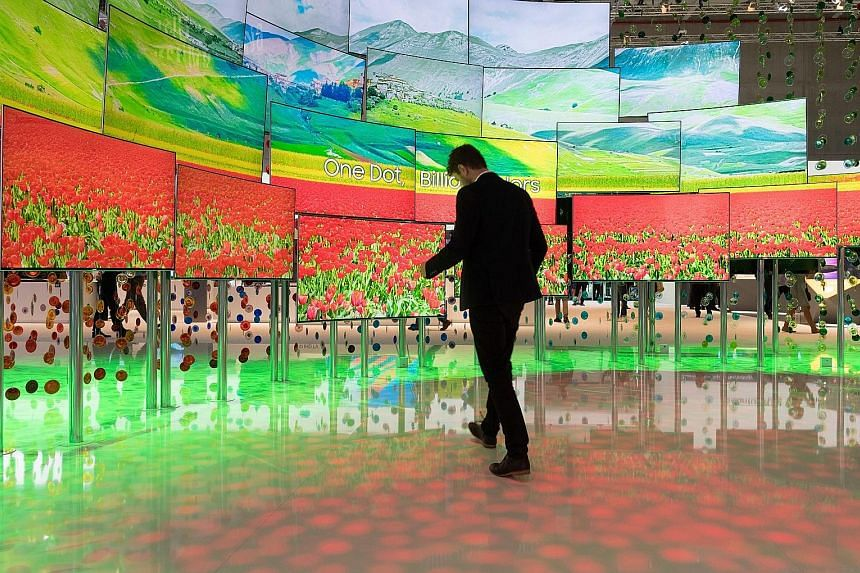 A wall of Samsung TVs with Quantum Dots technology at IFA in Berlin. The fair is the world's biggest for entertainment technology, IT and household appliances. LG's smart fridge has a 29-inch Windows 10 tablet as one of its doors. Among the fridge's