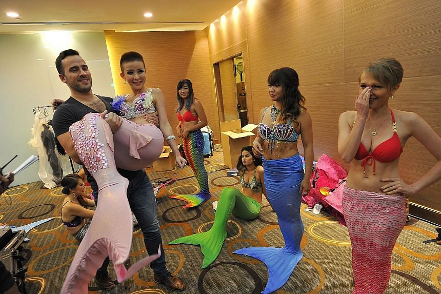 Miss Mermaid Singapore 2016 winner Audrey Chen, 25, an entrepreneur, being carried by a hotel guest to the stage at the Miss Mermaid Singapore Coronation Night at Village Hotel Changi yesterday. The hotel guest was one of the volunteers who offered t