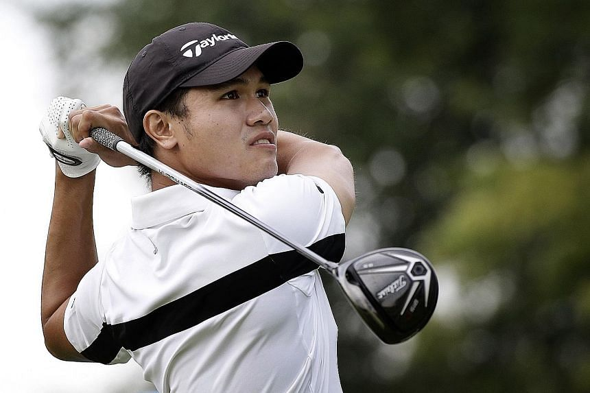 Singapore's top amateur golfer Gregory Foo tees off on the par-four 10th hole at Tanah Merah Country Club's Garden Course. He made par on his opening hole.