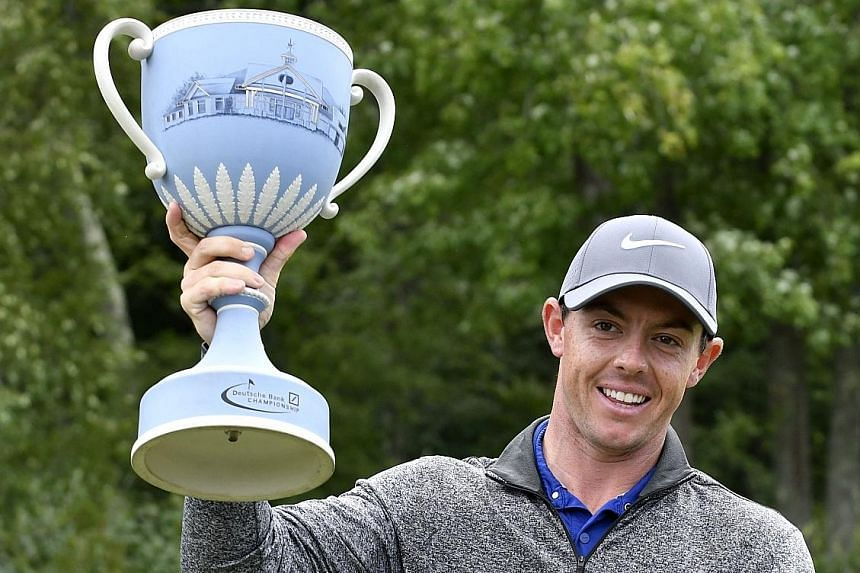 Rory McIlroy holds the trophy after winning the Deutsche Bank Championship. He overcame a bad start to go 19-under par over the last 69 holes.