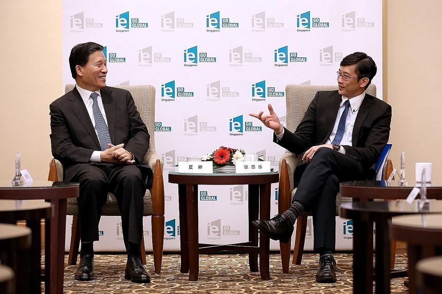 Minister of State for Manpower Teo Ser Luck (right) and Shandong Vice-Governor Xia Geng at the 19th Shandong- Singapore Business Council meeting yesterday. Mr Teo said there are opportunities for Singapore firms to tap emerging services sectors in Sh