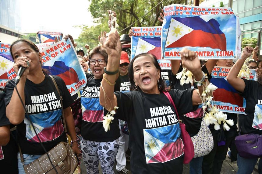 Filipino protesters shout slogans during a protest in front of the Chinese consular office in Manila on Aug 6, 2016.