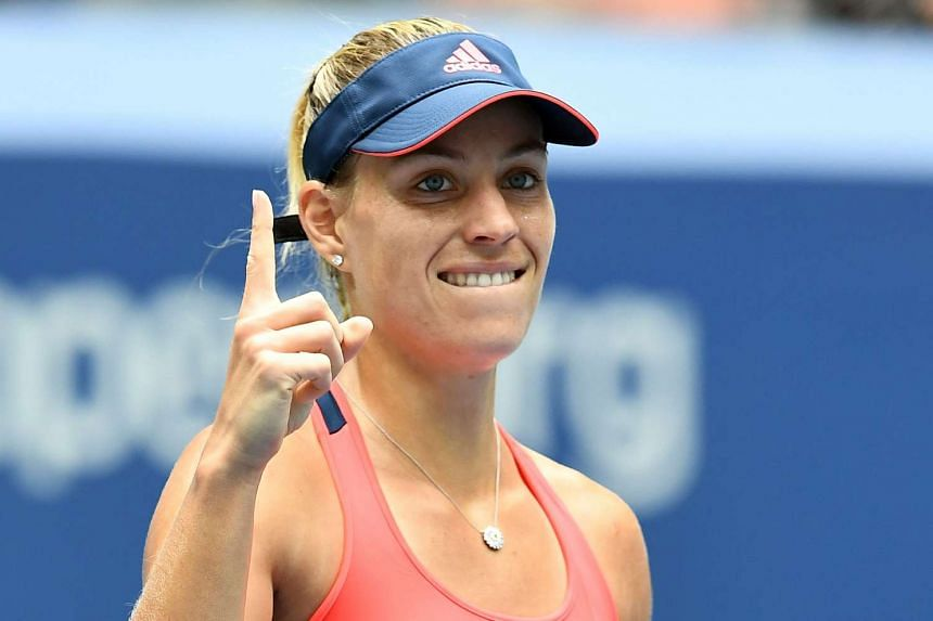 Angelique Kerber of Germany reacts after winning against Roberta Vinci of Italy.