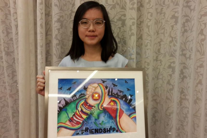 School of the Arts student Chin Ruisi, 16,  with her artwork, which used the theme of friendship bands to depict the relationship between Asean and China.
