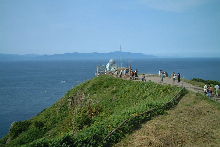 The Tsugaru Strait is a strait between Honshu and Hokkaido in northern Japan connecting the Sea of Japan with the Pacific Ocean.