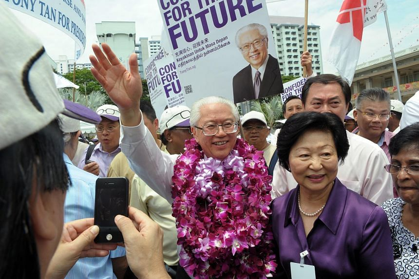 Dr Tony Tan Keng Yam (centre) and his wife Mary waving to supporters at the People's Association headquarters on Nomination Day, Aug 17, 2011, during the Presidential Election.