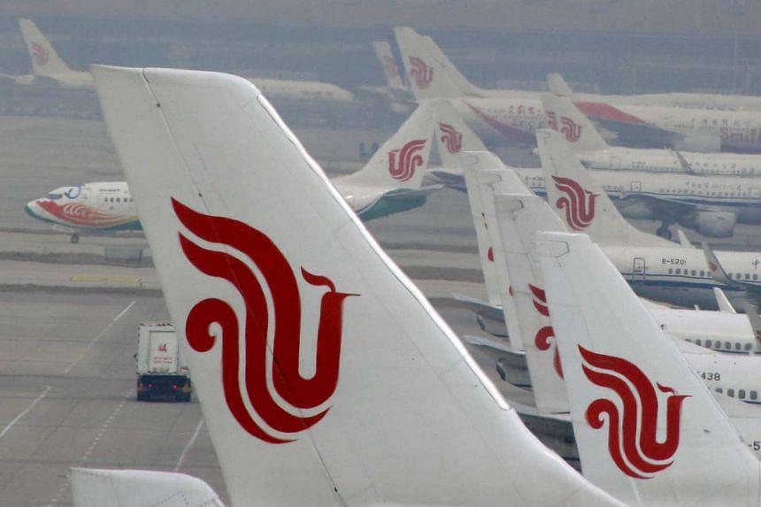 Air China planes parked on the tarmac of Beijing Capital International Airport in China on March 28, 2016.