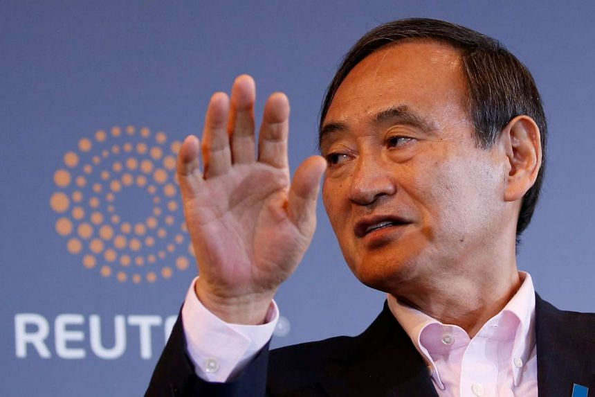 Japan's Chief Cabinet Secretary Yoshihide Suga attends a Thomson Reuters Newsmaker event in Tokyo, Japan, on Aug 30.