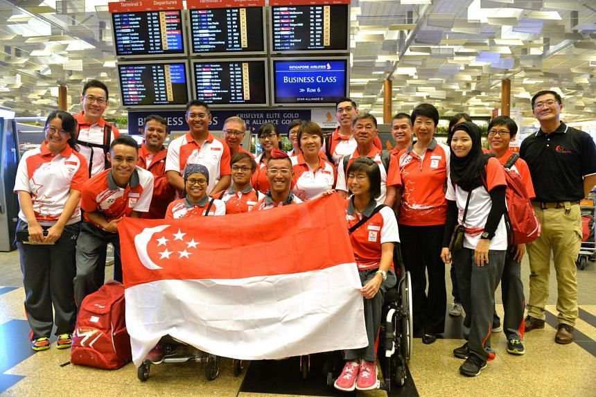 Para-athletes (front row, from second left) Suhairi Suhaini, Norsilawati Sa'at, Muhammad Diroy Noordin, para-sailors Jovin Tan, Yap Qian Yin and para-archer Nur Syahidah Alim (behind Tan) were in buoyant mood before flying to Rio de Janeiro for the