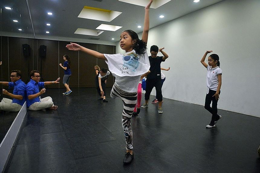 Singapore Chinese Girls' School pupil Regina Laletha (centre), 12, practising basic choreography with other participants at a ChildAid workshop.